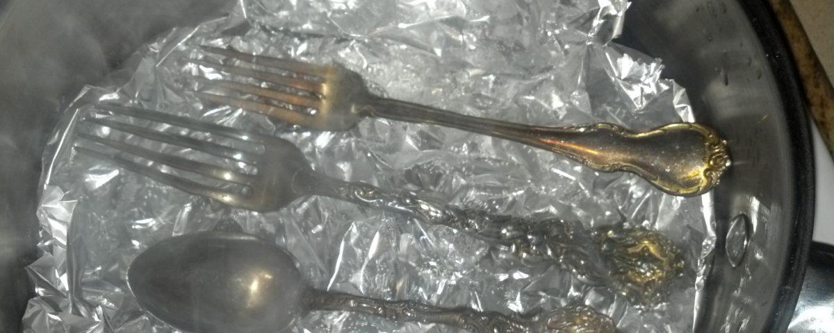 Silverware, beginning to lose the tarnish