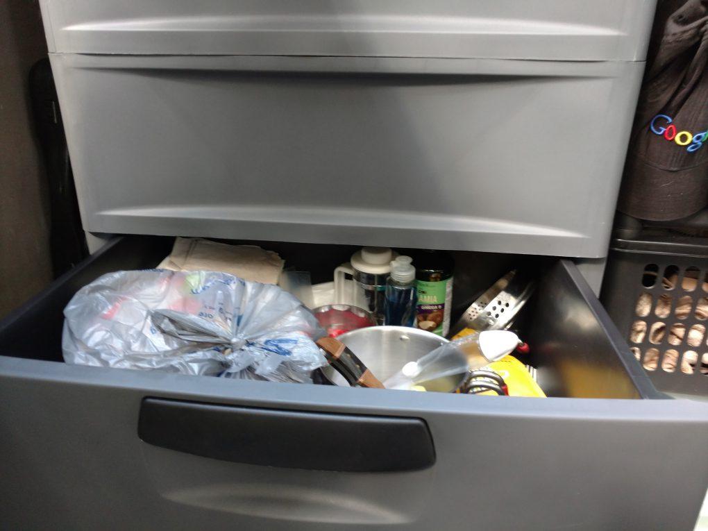 Kitchen supplies in lower drawer